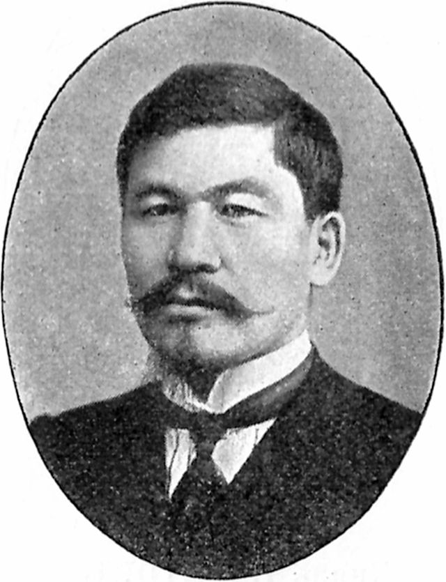 Image of Alikhan Bokeikhanov, an Kazakh man with a black moustache and goatee, black hair, and wearing a suit